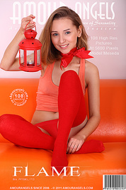 Lovely teenage cutie looks hot as she poses in red stockings and shows off her shaven twat.