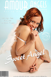 Naked red-haired angel sucking a candy and posing her lovely fresh figure