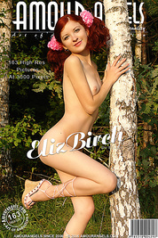 Red-haired teen in pink pants posing near birch trees taking slowly all her clothes off