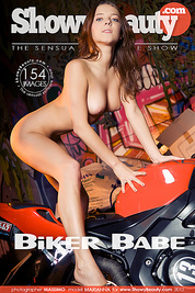 Charming girl with a gorgeous body strips off her bikini and poses totally nude on a bike.