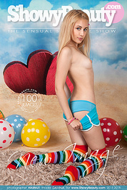 This nice and horny blonde girl totally looses it while she strips and plays with some colorful balloons.