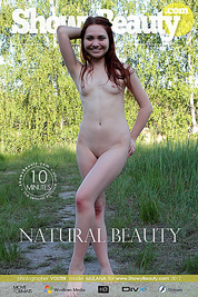 Incredible long haired redhead teen girl posing in the nude on the river in this video.